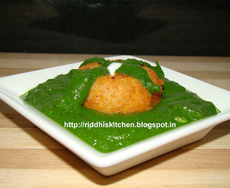 Potato Paneer Tikki In Spinach Gravy.