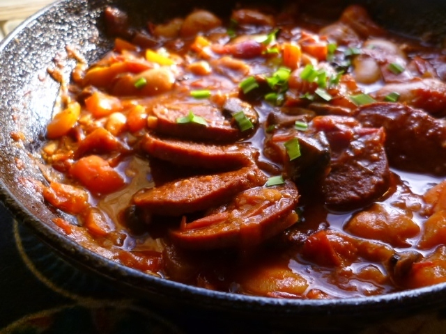 spicy butter bean and tomato stew with turkish sujuk (garlic sausage)