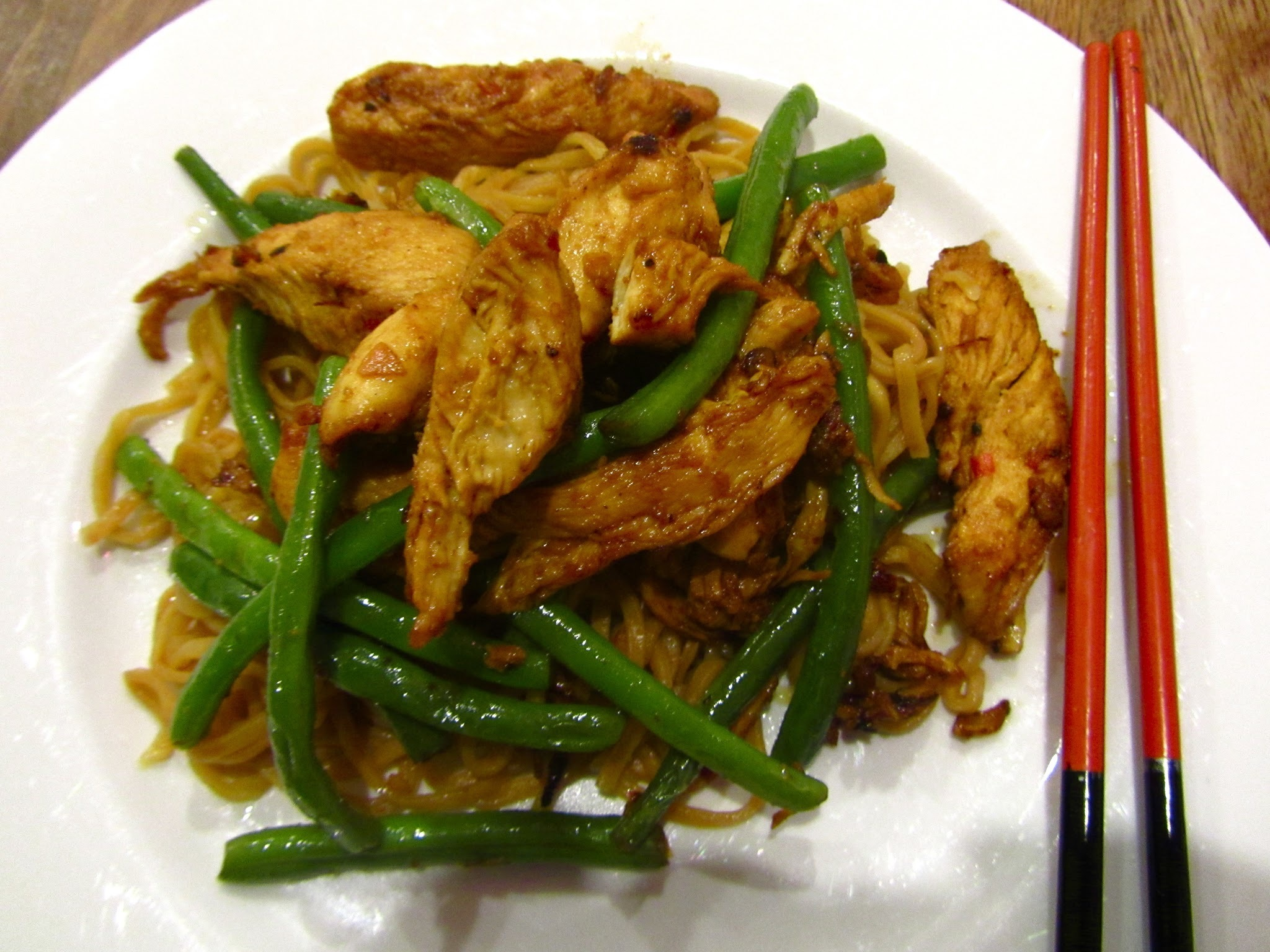 Stir fried chicken with ginger, chilli, garlic and lime