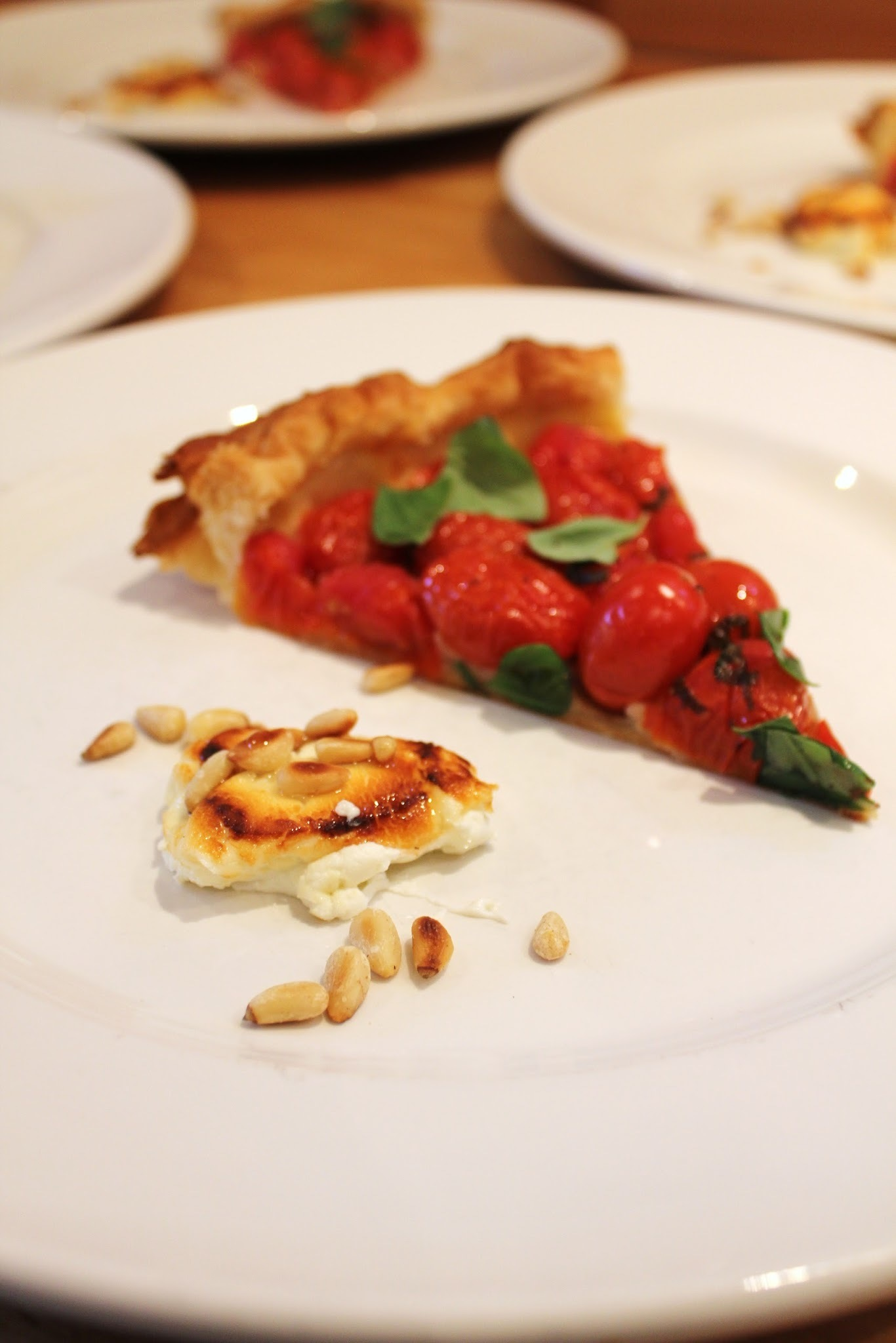 Baby Plum Tomato Tart with Grilled Goat's Cheese and Roasted Pine Nuts