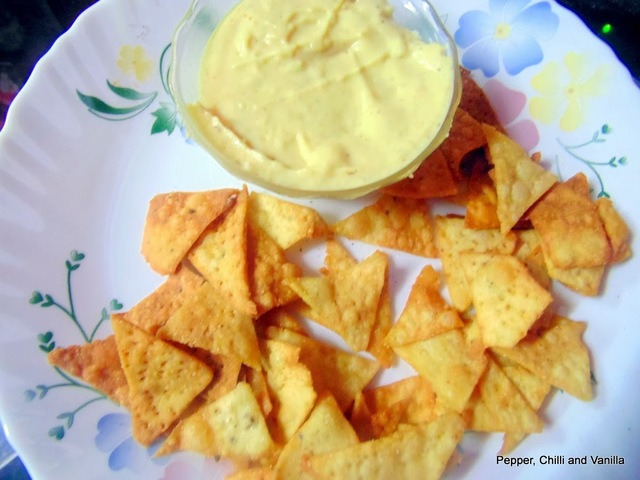 Home made Nachos / Corn chips with Nacho sauce.