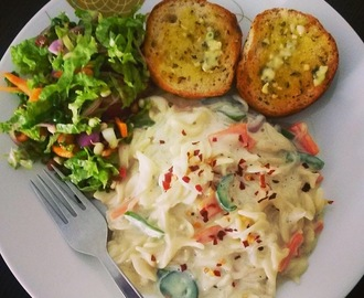 Pasta is White Sauce with Salad with a Honey-Mustard dressing, Masala Bun with Herbed Garlic Butter