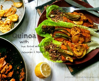 Quinoa salad on a bed of lettuce,pan fried salmon,jalapenos & squash
