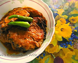 Rui Tomato ( Rohu Fish In Thick Tomato Gravy Tempered with Nigella Seeds And Slit Green Chillies)