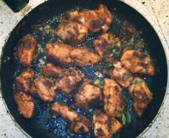 Shallow fried Spicy Chicken in a non stick kadai. Tastes similar to Chicken 65