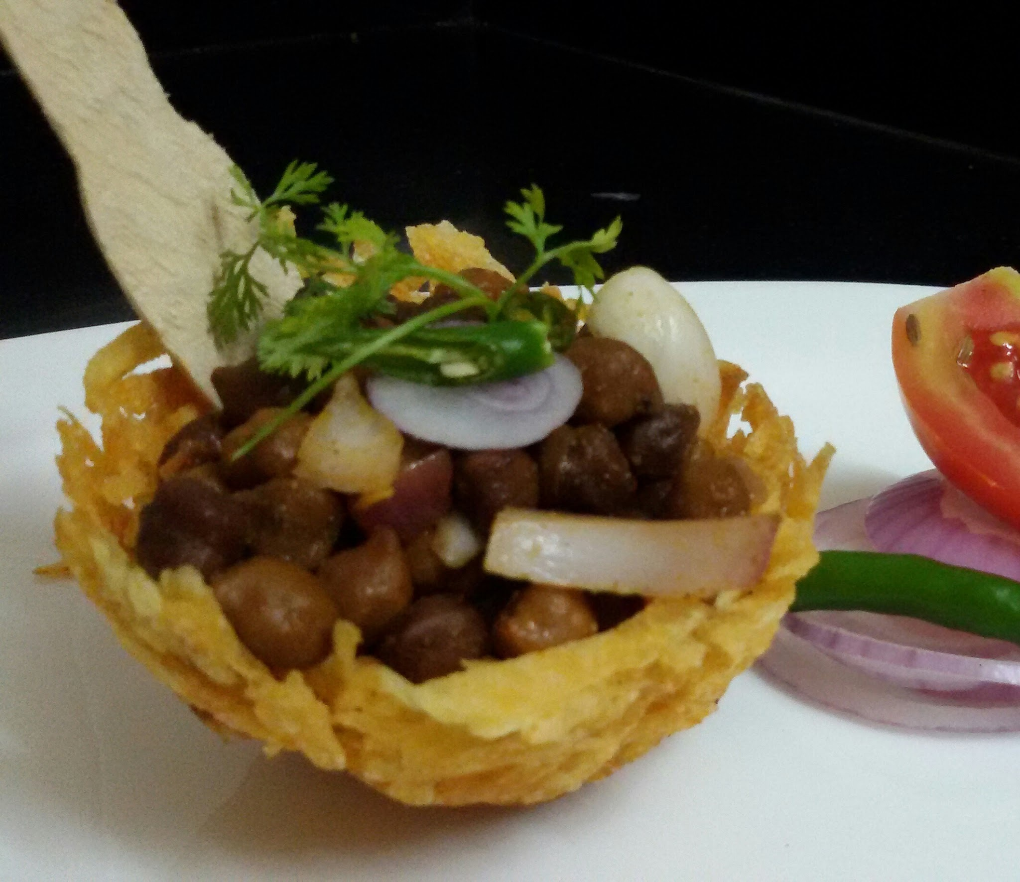 Dry Chickpeas  Chaat  in Edible  Crispy Potato  Basket ....Chana Chaat in Crispy  Aloo  Tokri