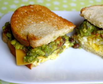 Eggy Sandwich topped with a Spicy Black Bean and Tomato Guacamole