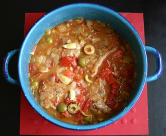 Pork Chops Stewed in an Olive, Tomato and Lemon Sauce