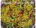Masala Puri with Green Leaves or Spicy Salad.