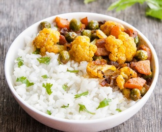 Cilantro lime coconut rice served with stir fried carrots, cauliflower and Green Peas