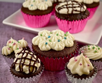 Chocolate Cupcakes w/ Cream Cheese frosting and a hidden surprise.