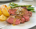 Seared Steaks and Green Peppercorn Sauce with Roasted Potatoes and Green Beans