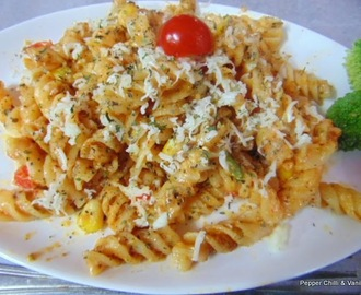 Cheesy Fusilli Pasta with Tomato sauce.