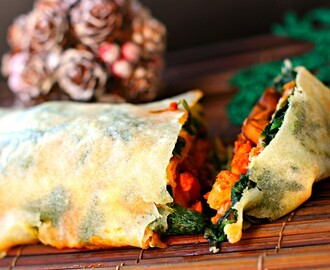 Hot and spicy mushroom and cauliflower baked giant spring roll with a cheesy spinach layer for a vegetarian Christmas