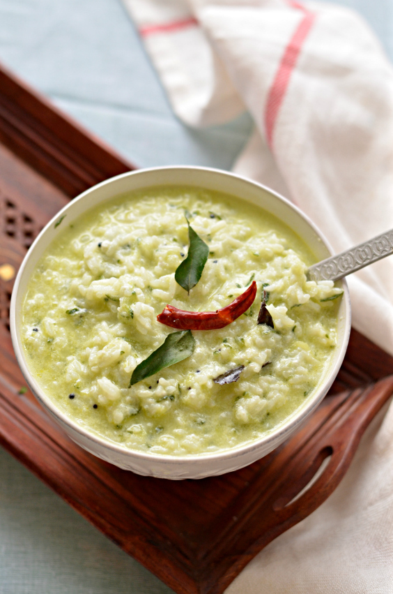 Curd rice with cucumber – Rice cooked with yoghurt, milk and Indian spices