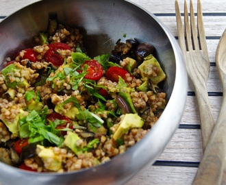 Buckwheat bowl with avocado, cherry tomatoes and aubergine