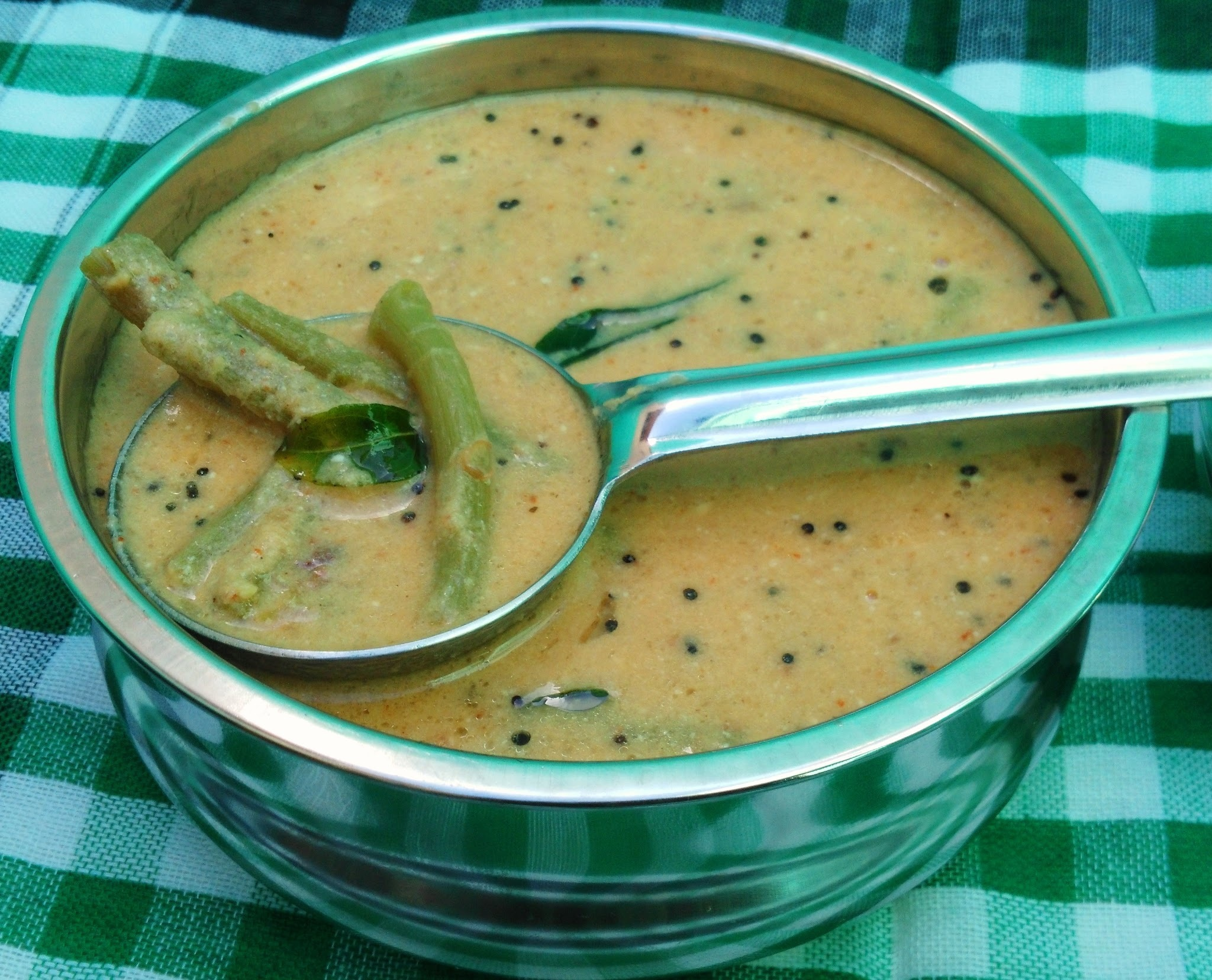 Keerai Thandu Thengai Kuzhambu ( A gravy with the tender stems of Amaranth leaves)