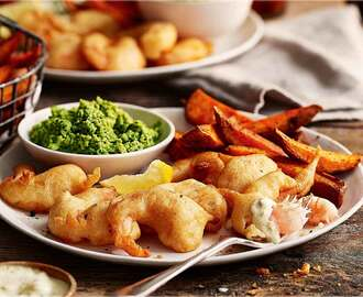 Beer-battered scampi with sweet potato chips and mushy peas recipe