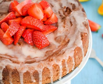 Eggless Strawberry and almond meal cake with orange glaze and more strawberries