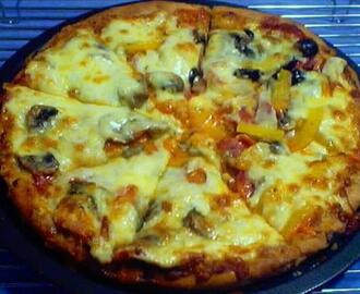 Homemade Pizza With Mild Tomato Sauce
