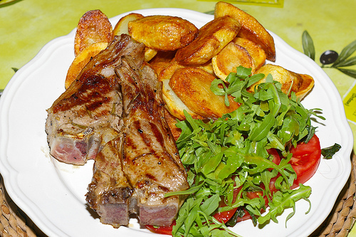 Lamb chops with sautéed potatoes and salad