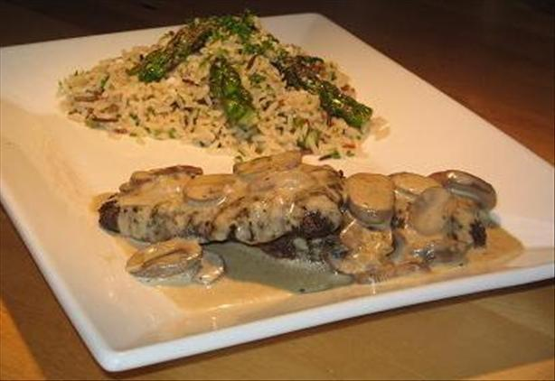 Ostrich Steaks With Mushroom Vanilla Sauce and Wild Rice With As