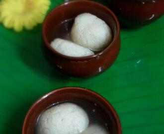 Rasgullas or Rosogolla ( Bangali  Spongy  Rasgullas ) cottage cheese balls soaked in  sugar syrup