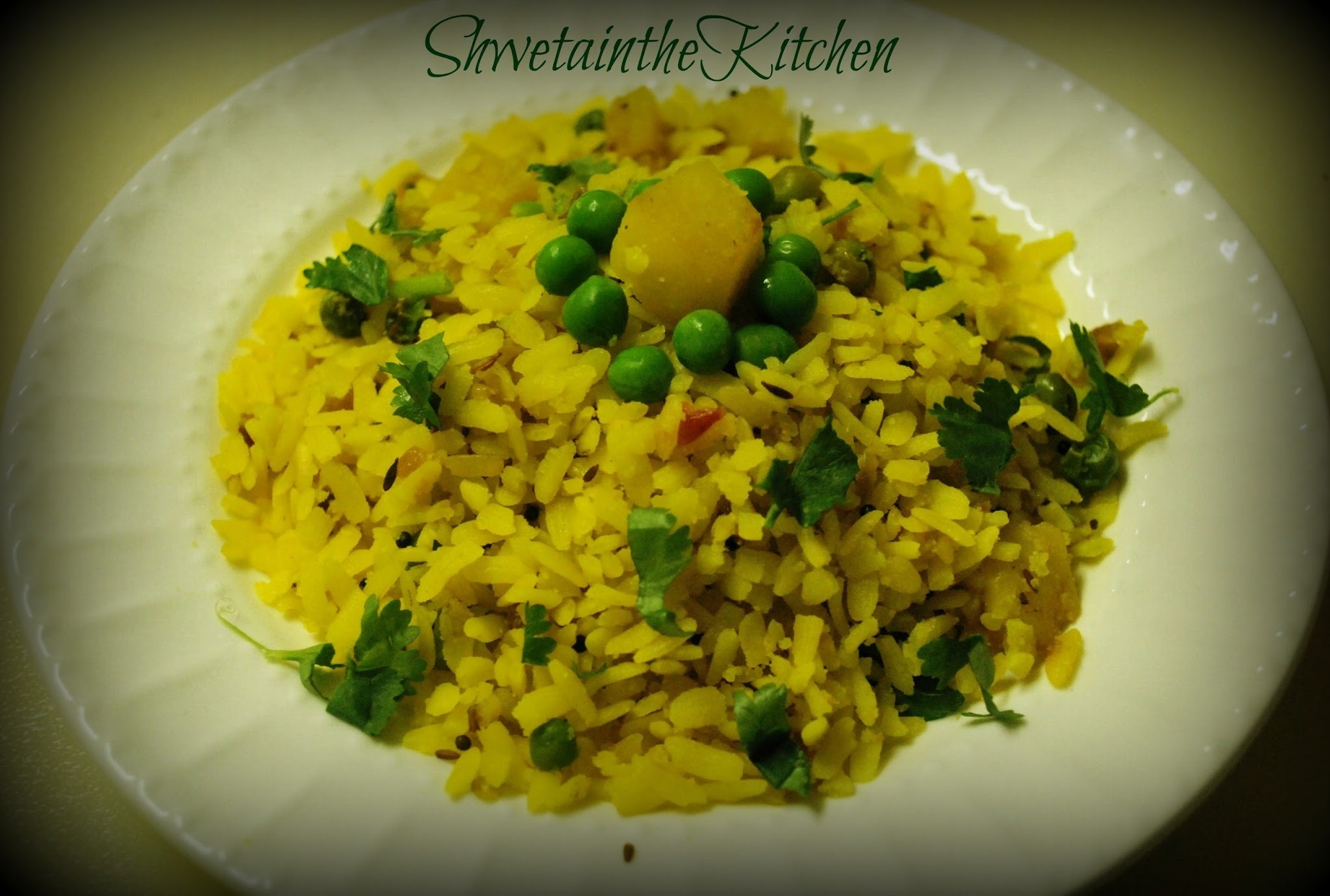 Poha - Pohe - Flattened rice with Onions, Potato & Green peas