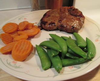 Baked Honey Glazed Pork Chops w/ Sugar Snap Peas, Sliced Carrots, and...