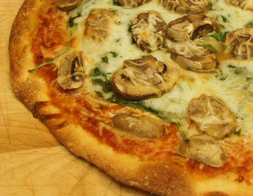 PIZZAS WITH TOMATO PESTO SAUCE AND FRESH MUSHROOMS
