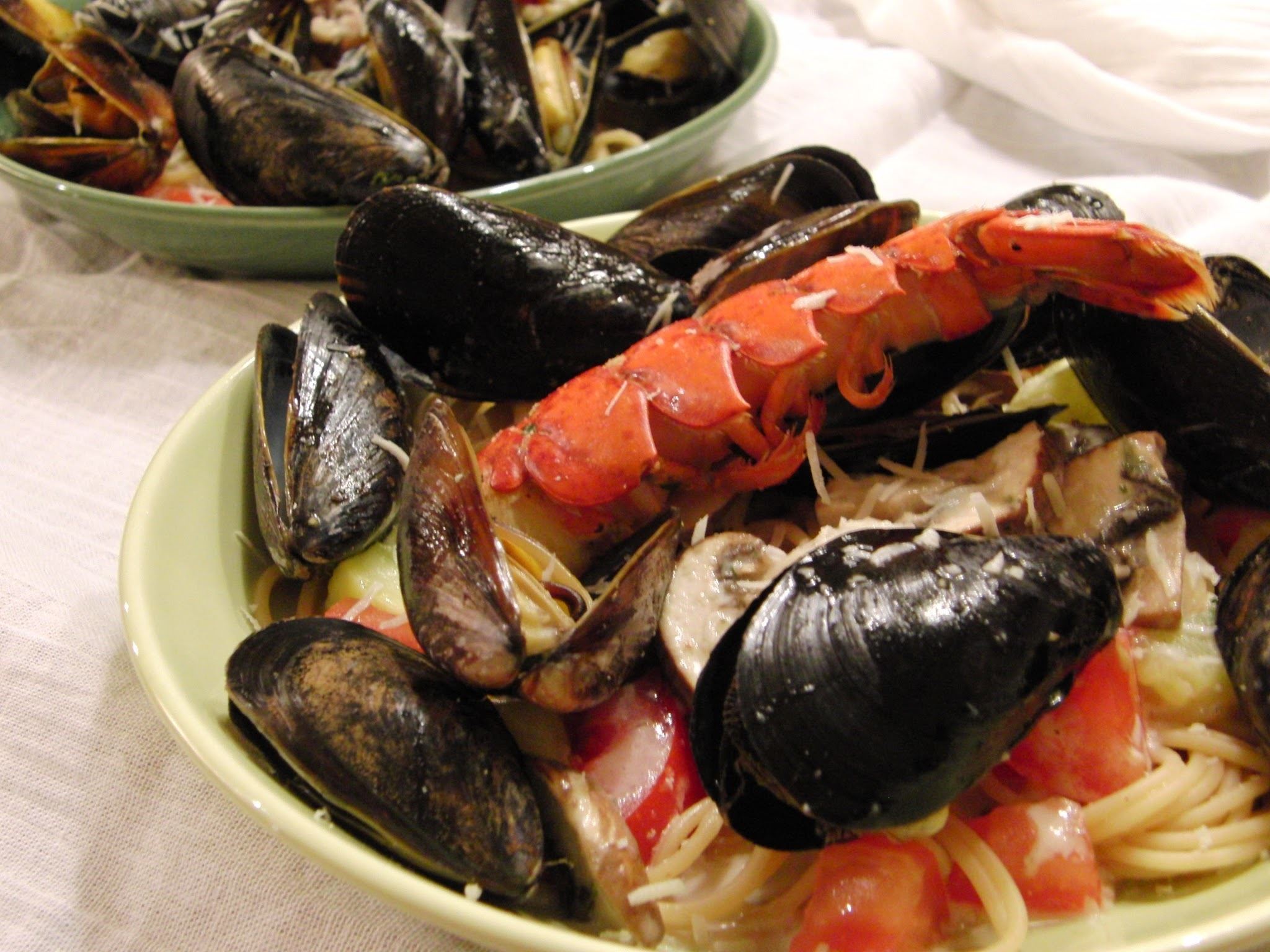 A romantic meal at home...  Pasta with Steamed Mussels and Lobster, with a Creamy White Wine Sauce