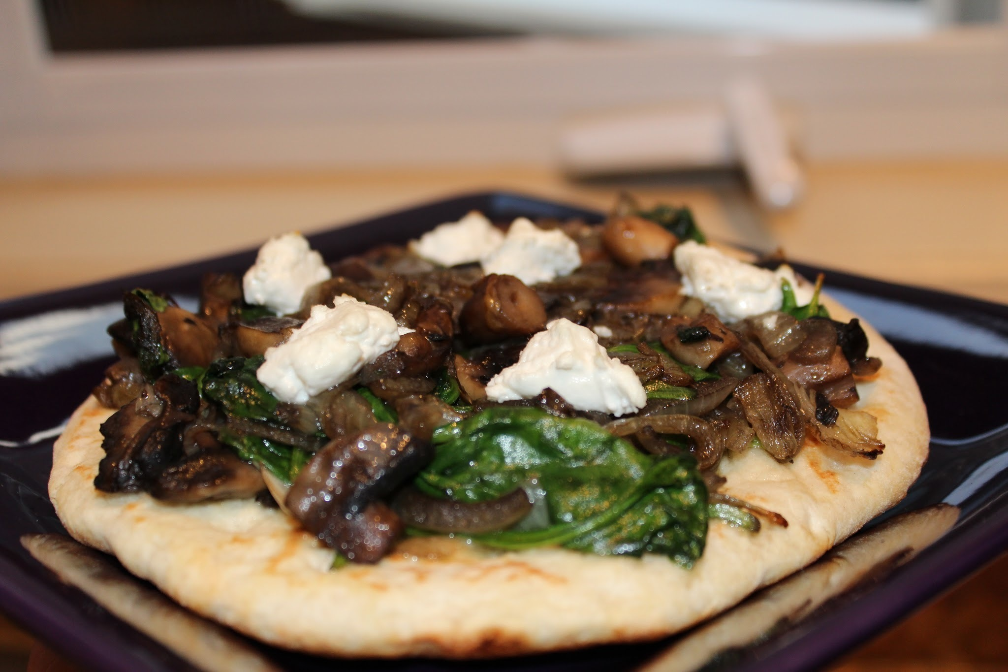 Baked Pita Bread with Spinach, Mushrooms and Goat's Cheese