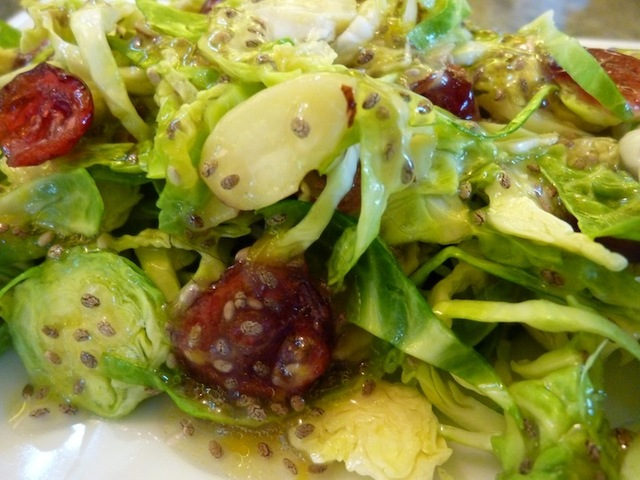Raw Vegan Brussels Sprouts Salad With Orange Chia Seed Vinaigrette, Dried Cranberries (Or Pomegranate Seeds) And Almonds - Perfect For Thanksgiving!