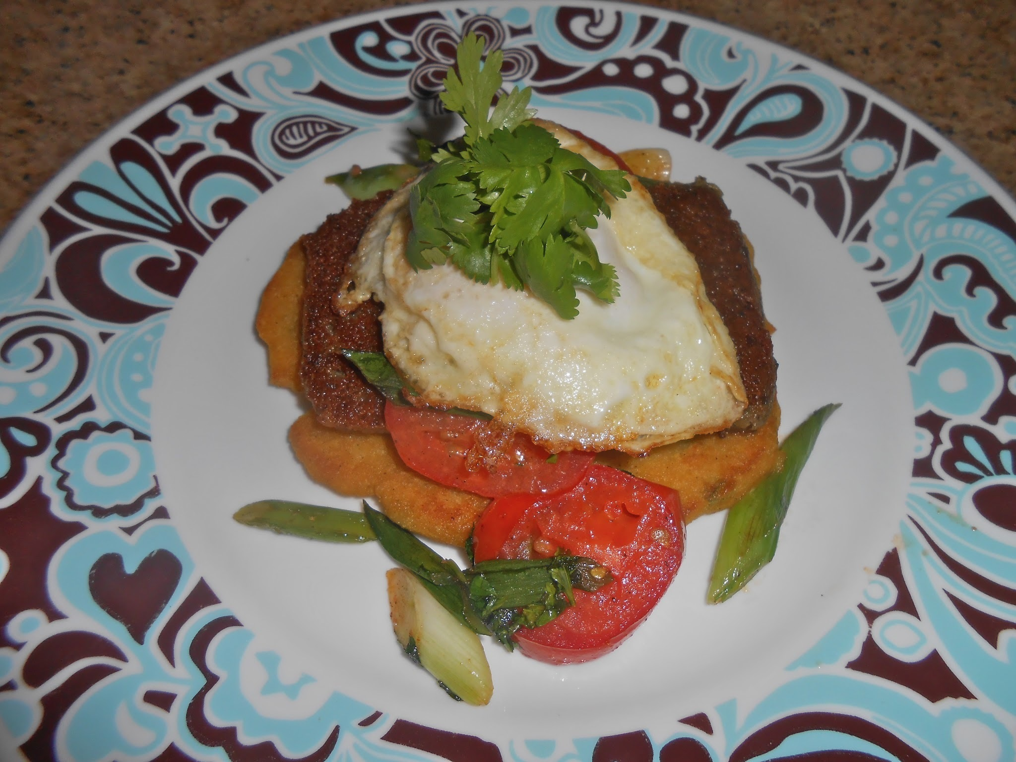Scrapple and Egg on Pan Fried Jalapeno Corn Bread with Cilantro Green Onion Tomato Saute
