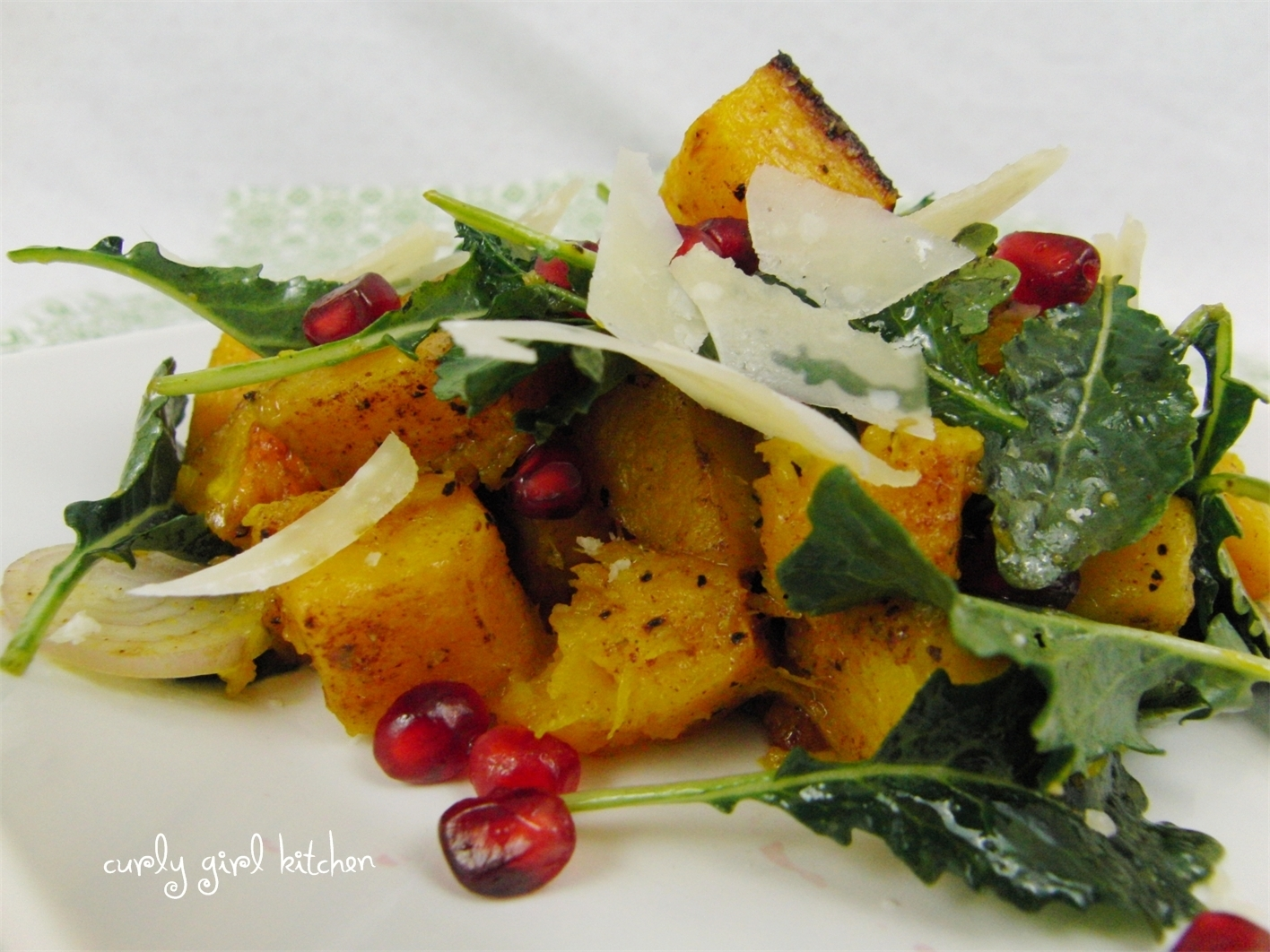 Winter Squash Salad with Pomegranate Arils and Wilted Greens