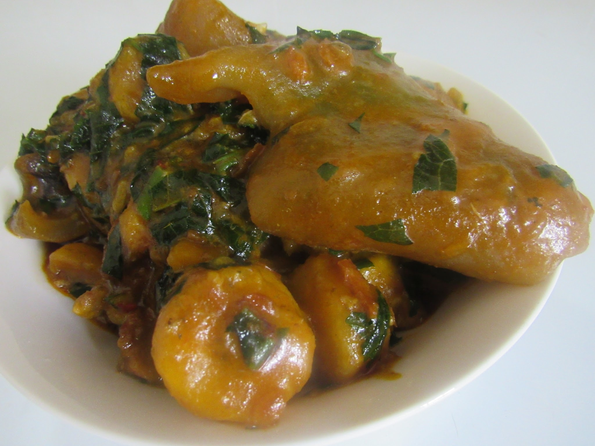 Nigerian plantain porridge with ugu vegetable (Fluted pumpkin)
