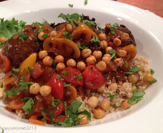 Lamb and feta cheese meatballs with chickpea cous cous and a tagine style sauce.