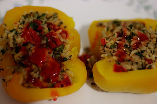 Bell Peppers stuffed with Rice, Spinach and Tomatoes