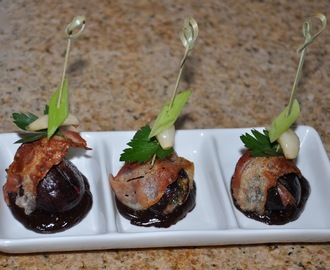 Smoked Bacon Wrapped Mission Figs stuffed with Basil and Fontal on Balsamic Chocolate Ganache