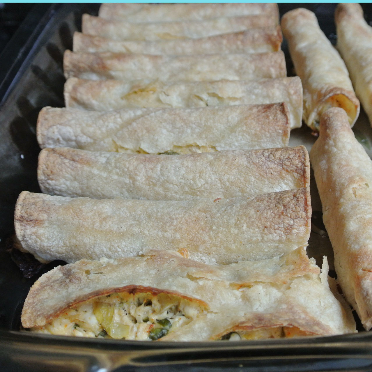 Creamy Spinach Artichoke Chicken Taquitos