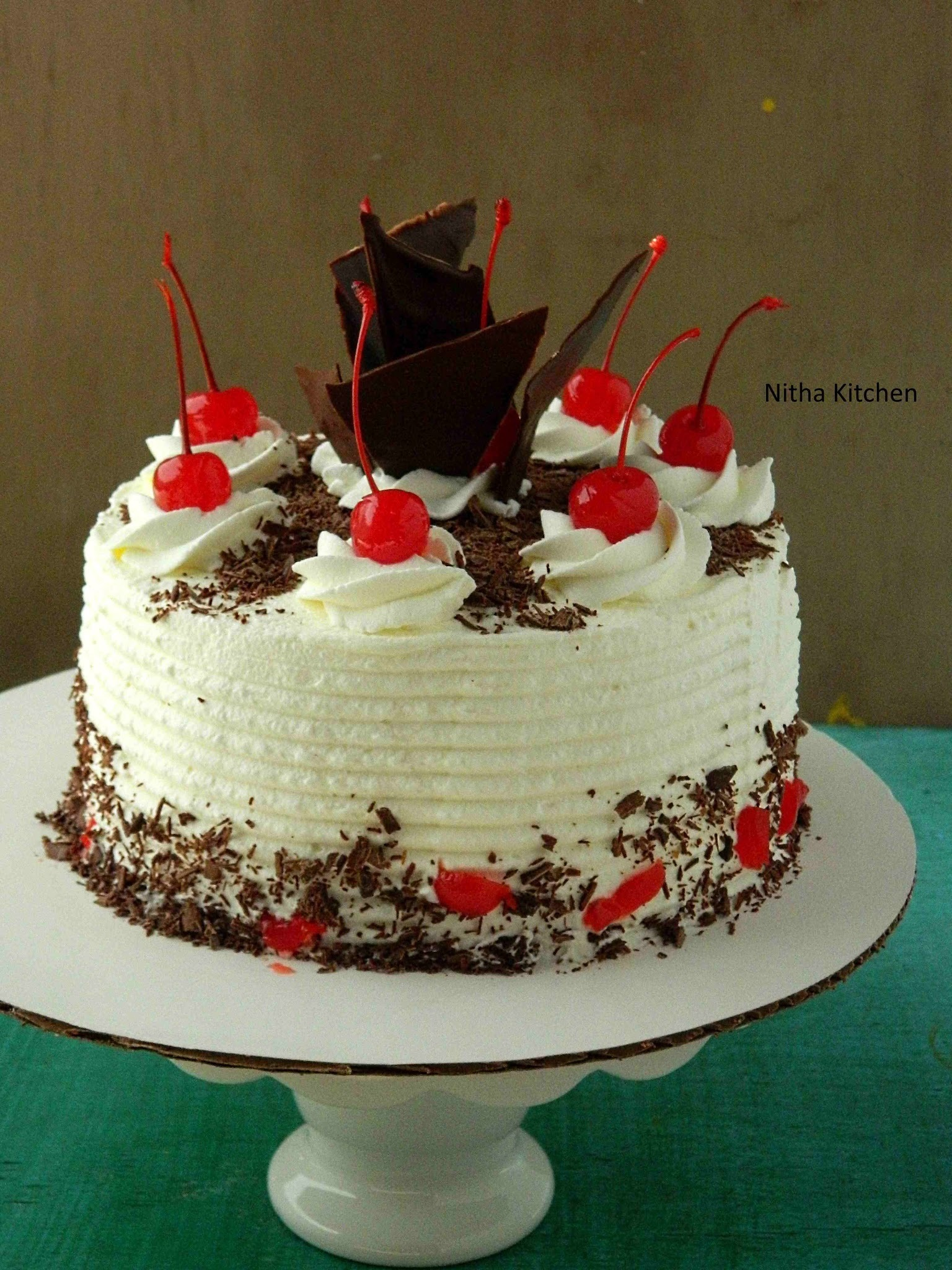 Eggless Black Forest Cake with layers of Hot Chocolate Sponge | A Scratch Recipe with step by step Pictorial For Beginners!