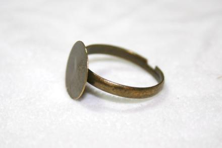 Reglerbar ringstomme antique bronze metall platta