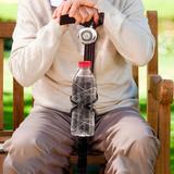 Träkäpp med ringklocka och flaskhållare