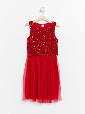 Glittrig tyllklänning med paljettöverdel