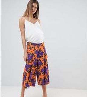 ASOS DESIGN Maternity low rise bump band wide leg culottes with flowing hem in orange floral print - Orange floral