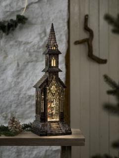 Vannfylt lykt kirke med glittereffekt