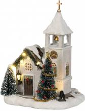 Hvit kirke til landsby - juleby Luville