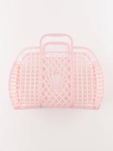 Vaaleanpunainen muovinen verkkolaukku