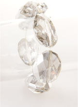 Transparant / zilveren stretch armband met facetkralen
