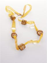 Goudkleurige ketting van kant en spiegeltjes-kralen